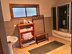Immaculate main bathroom with plush towels and a sauna for warming up on cooler days