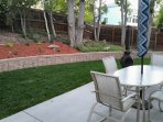 Large patio, lawn, and open back yard