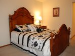 Master bedroom has a queen size bed