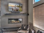 Stunning fireplace and flatscreen smart TV in the living area