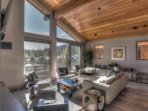 Extremely spacious living area with vaulted ceilings and floor to ceiling windows
