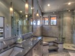 The incredible master bath has 2 sinks, a walk-in shower, and a jacuzzi tub