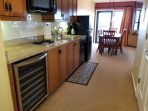 Kitchen- wine cooler, electric stove, coffee maker, microwave, full size fridge, dishwasher.