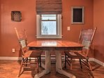 Share intimate meals at this wooden dining table with seating for 2.
