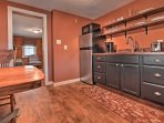 Around the corner you'll find the well-equipped kitchen with stainless steel appliances.