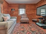 Pine-paneled walls enhance the charming alpine ambiance of this newly renovated cottage.