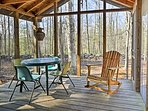 Relax with a glass of wine on the screened porch.