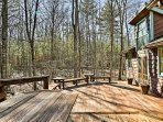 Spend sunny days lounging on the spacious deck surrounded by beautiful woodlands.