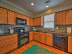 The fully equipped kitchen features granite countertops and a double oven.