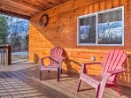 Claim a seat in one of the Adirondack chairs.