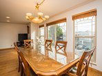Comfortable, light-filled dining area with views and room for 8.