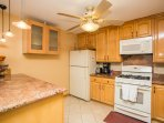 Kitchen has granite counters, lots of cabinets, gas stove and all necessary items for a gourmet meal