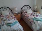 Back twin bedded room, with 2 seater sofa