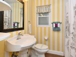 full shower bathroom on the hallway shared by the queen and king bedroom