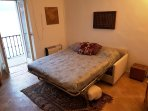 2nd flr. studio bedroom, large divan-bed, table, wardrobe & drawers  great view.