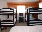 Bedroom 2 with full bed and two twin bunk sets