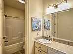 You'll find a separate shower/tub combo in this second full bathroom.