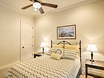 The second bedroom features a cozy queen bed.
