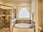 Enjoy a long soak in the built-in garden tub or refreshing rinse in the walk-in shower.