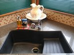 Kitchen sink with new sponge and soap provided