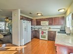 Prepare your favorite recipes in the open fully equipped kitchen.