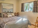 This bedroom offers a plush queen bed.