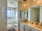 Rinse off after your daily activities in the master en-suite bathroom.