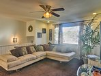 Cozy up on the L-shaped couch in the living area while watching a movie on the 60-inch flat-screen cable TV.
