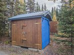 The cabin is nestled among other vacation rental cabins at the 'Kenai Magic Lodge.'