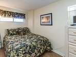 Third bedroom with queen size bed and TV.