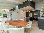 Open concept eat in kitchen overlooking living room