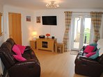 Comfy lounge with views of Fistral Beach and the private garden
