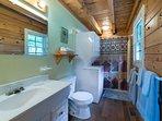 Ground floor shower into tub. Washer & dryer