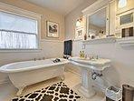 A classic claw foot tub highlights the third bathroom.