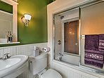 Rinse off before bed in the en-suite bathroom offering a shower/tub combo.