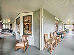 Enjoy peaceful days on the wraparound deck with ample seating for everyone.