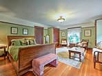 Spread out in the spacious second master bedroom featuring a love seat and quiet sitting area.