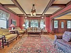 Wood beam ceilings and stained glass windows add vintage charm to the interior.
