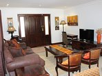 Living Room.  Flat screen television with USB port and full DSTV package