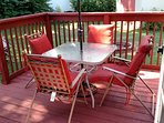 Back yard deck, accessible from 2nd FR. There is more lawn furniture including dining table.