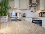 Fully equipped kitchen with granite work surfaces