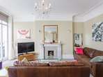 Regency Lounge with floor to ceiling french windows to full length balcony
