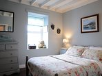 Down stairs double bedroom with exposed beams