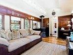 Sitting room with cozy Godin wood burning fireplace
