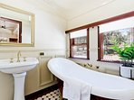 Ensuite bathroom with shower and slipper bath