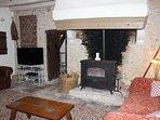 Large log burner with impressive fire place
