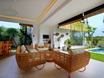 living room facing pool and ricefields