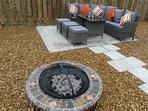 Outdoor seating area with fire-pit and barbecue