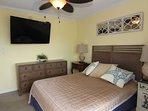 Bedroom 3 showing dresser and tv