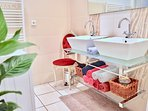 Family Bathroom with 2 sinks, bath, shower and washing machine.